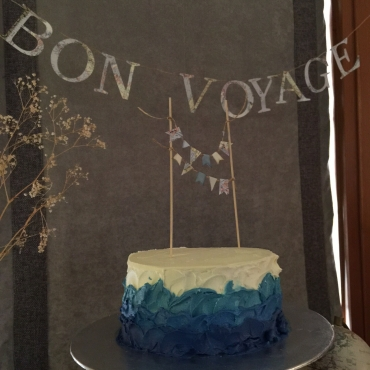 Bon Voyage banner and cake topper